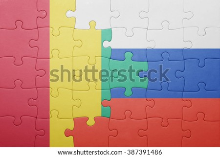 puzzle with the national flag of russia and guinea . concept - stock photo