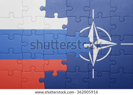 puzzle with the national flag of russia and nato . concept