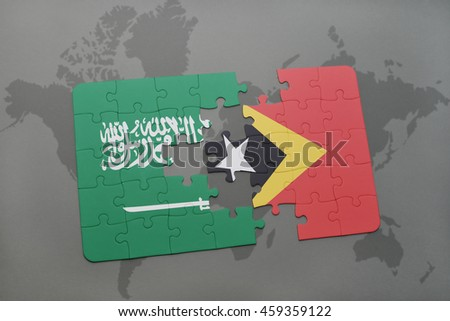puzzle with the national flag of saudi arabia and east timor on a world map background. 3D illustration