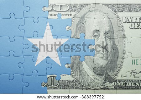 puzzle with the national flag of somalia and dollar banknote . concept