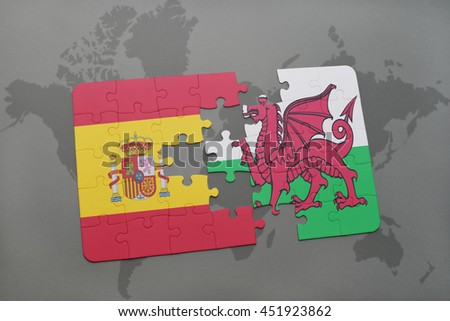 puzzle with the national flag of spain and wales on a world map background. 3D illustration - stock photo