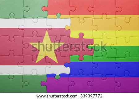 puzzle with the national flag of suriname and gay flag.concept - stock photo