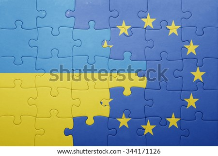 puzzle with the national flag of ukraine and european union . concept