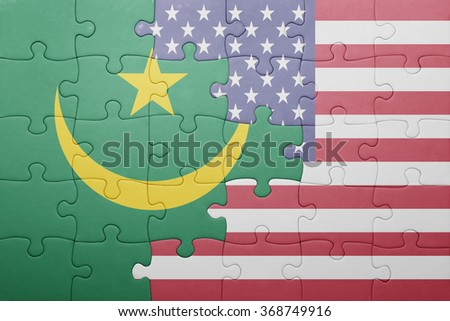 puzzle with the national flag of united states of america and mauritania .concept
