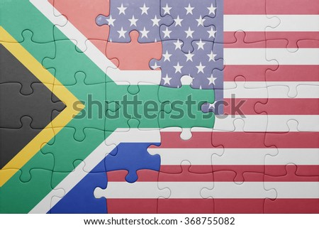 puzzle with the national flag of united states of america and south africa .concept - stock photo