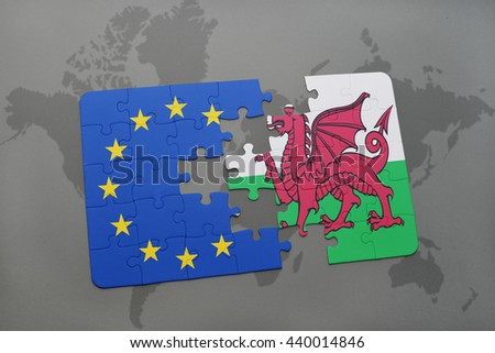puzzle with the national flag of wales and european union on a world map background. - stock photo