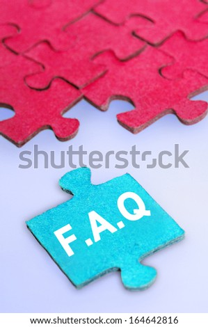 Puzzle word FAQ on blue background - stock photo