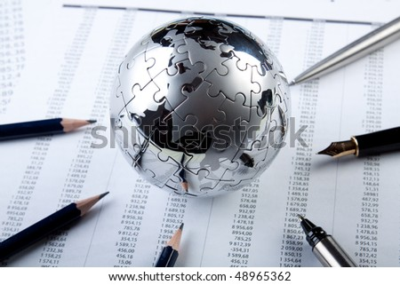 puzzle world and a lot of pens - stock photo