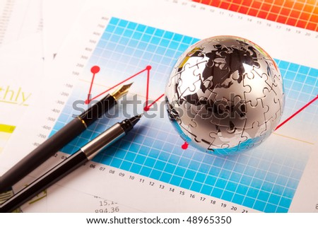 puzzle world, pen and graph - business concept - stock photo