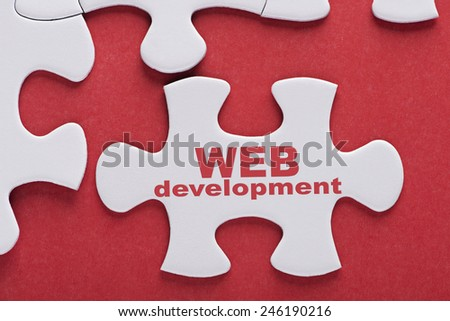 Puzzle written word Web Development - stock photo