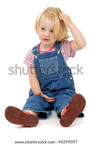 Puzzled child on a white background - stock photo
