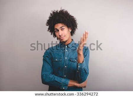 puzzled young man  - stock photo