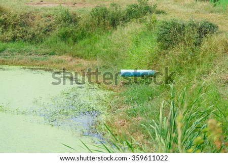 PVC drainage pipes in irrigation canal, sewage and water for cultivation - stock photo