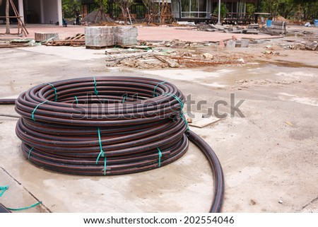 PVC pipe to roll the construction site. - stock photo