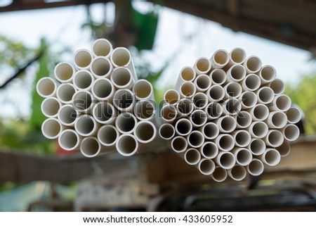 PVC pipes for electric conduit and water (white)  - stock photo