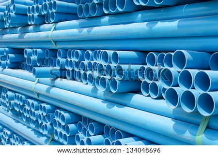 PVC pipes stacked in construction site - stock photo
