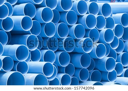 PVC pipes staked in construction site - stock photo