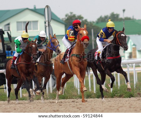 PYATIGORSK,RUSSIA - AUGUST 15:The race for the prize of the Ogranichitelni;The jockey Isakov,Mardanov,Gabidulin and Saitgaleev. August 15; 2010 in Pyatigorsk; Caucasus; Russia.