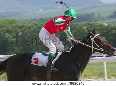 PYATIGORSK, RUSSIA - JUNE 5:Jockey Hamid Ulubaev cross the finish line first in a horse race for the prize of the Probni on June 5, 2011 in Pyatigorsk, Caucasus, Russia.