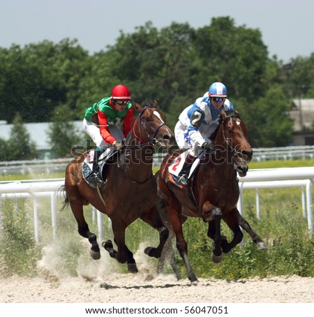 "PYATIGORSK, RUSSIA  - JUNE 13: The race for the prize of the ""Russia Day"";The jockey Hatkov and Smirnov. June 13; 2010 in Pyatigorsk; Caucasus; Russia."