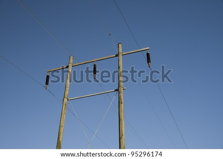 Pylon Against the Blue Sky on a winter day