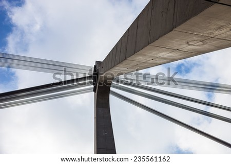Pylon and cables of the Moskovskiy cable-stayed bridge in Kyiv, Ukraine - stock photo