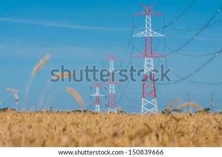 Pylon and transmission power line - stock photo