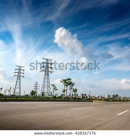 Pylon in substation blue sky white cloud background - stock photo