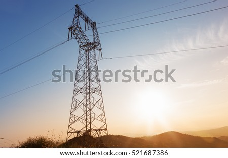 pylon stands on hilltop.