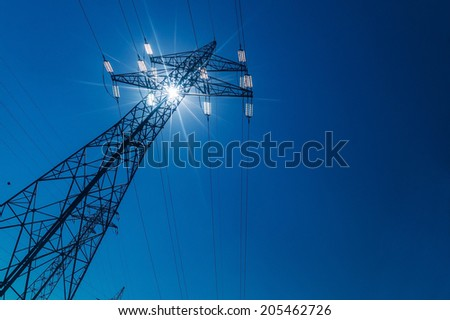 pylon, symbolic photo for energy production, supply and electricity network - stock photo
