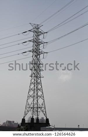 Pylon tower structure viewed from below against blue sky - stock photo