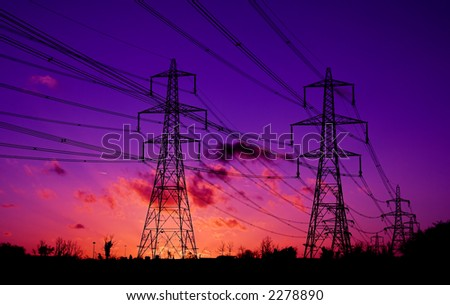 pylon towers during fiery sunset