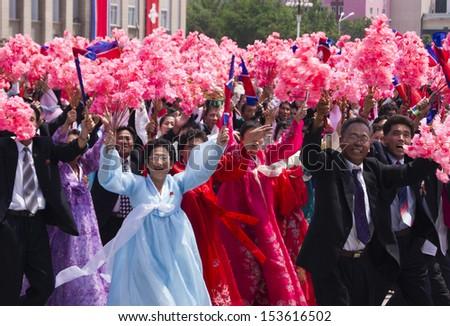 PYONGYANG, NORTH KOREA - JULY  27,  2012 : North Korean people at the military parade in Pyongyang - stock photo