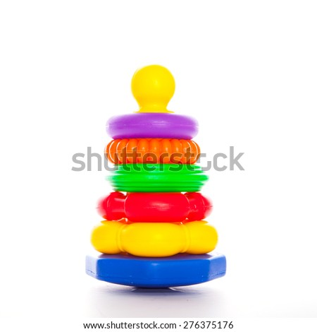 Pyramid build from colored plastic rings on the white - stock photo