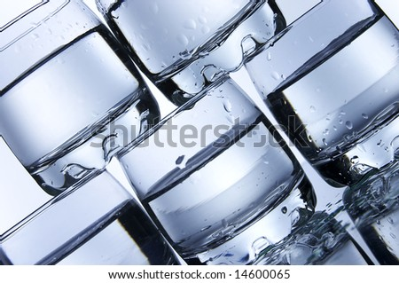 Pyramid from glasses with vodka - stock photo