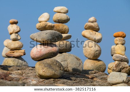 Pyramid from stones under a blue blue sky - stock photo