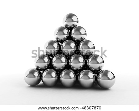 Pyramid made from metal balls. - stock photo