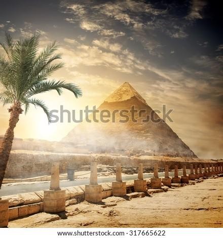 Pyramid of Khafre near road at sunlight - stock photo