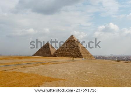 Pyramid of Khafre (Pyramid of Chephren) and Pyramid of Cheops, Giza Necropolis, Egypt - stock photo