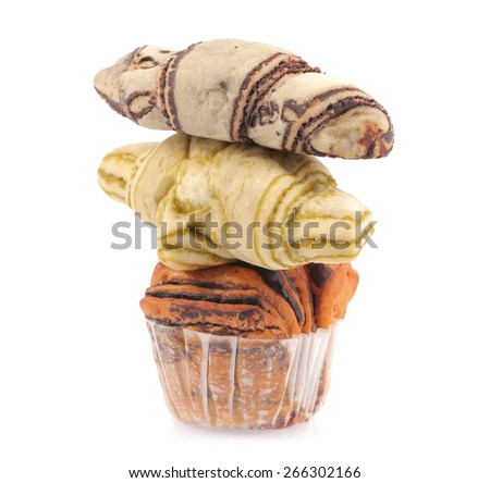Pyramid of muffins with croissants isolated on a white background - stock photo