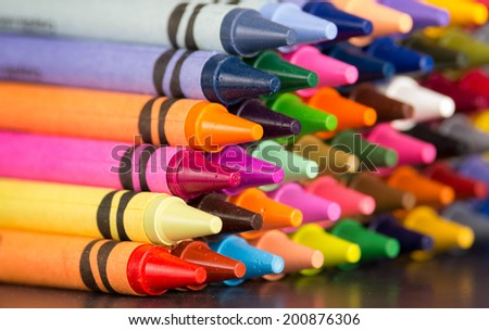 pyramid of multicolored new crayons bright closeup - stock photo