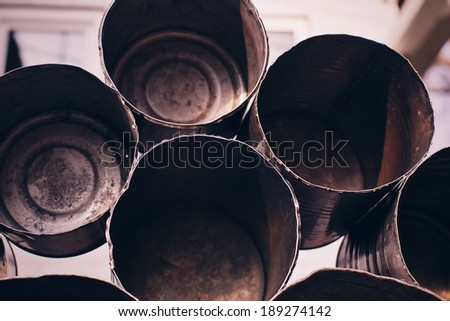 pyramid of old cans - stock photo