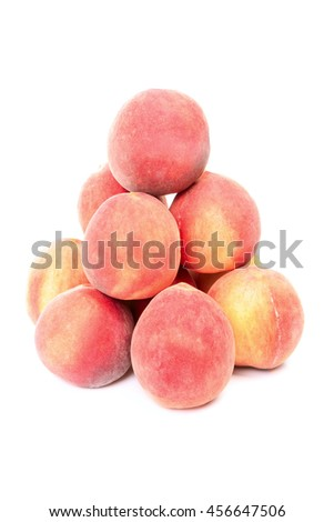 Pyramid of peaches isolated on white background - stock photo