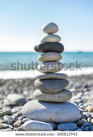 Pyramid of stones for meditation lying on sea coast