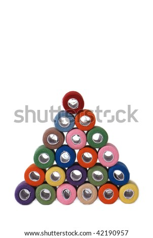 pyramid of threads (face view) isolated on white - stock photo