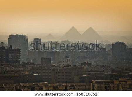 Pyramids in the mist, Cairo, Egypt. Largest city in Africa. - stock photo