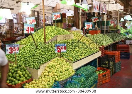 Pyramids of limes, Merced Market, Mexico City, Mexico - stock photo