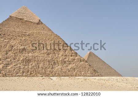 Pyramids, the second greatest pyramid with the great pyramid in the background. This photo was taken in Gizeh, Egypt.