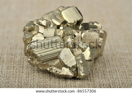 pyrite in the background of a burlap - stock photo