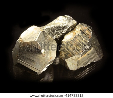 Pyrite isolated on black - stock photo